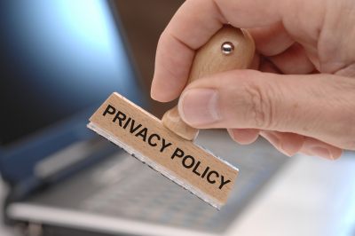 Privacy policy marked on rubber stamp in hand